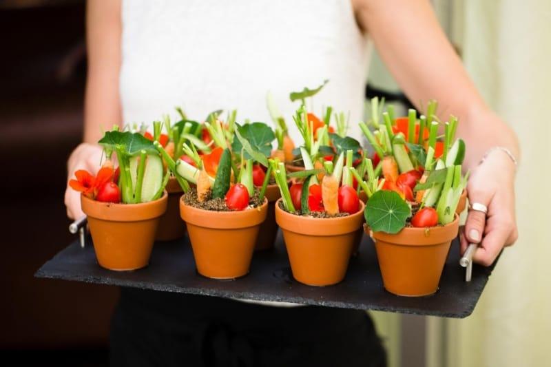 Bridebook.co.uk- vegetables in little pots at wedding reception