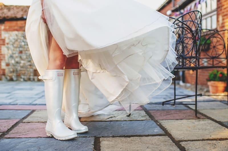 Bridebook.co.uk- bride wearing a pair of white weddingtons