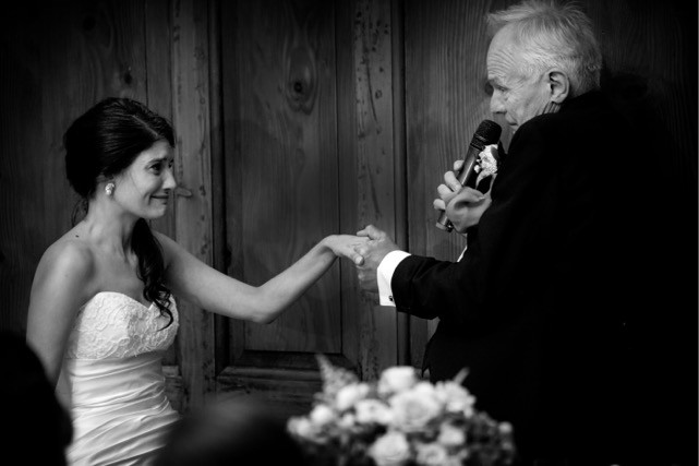 Bridebook.co.uk-bride and father hold hands as he delivers his speech