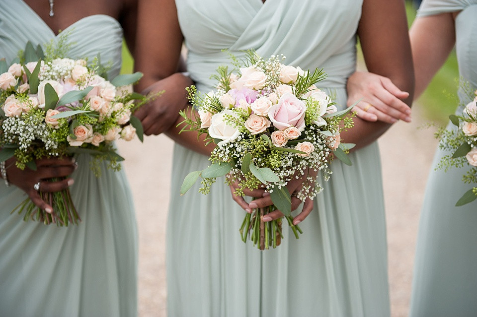 Bridebook.co.uk- bridesmaids holding up wedding bouquets