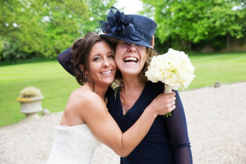 Bridebook.co.uk- bride and mother hugging and smiling