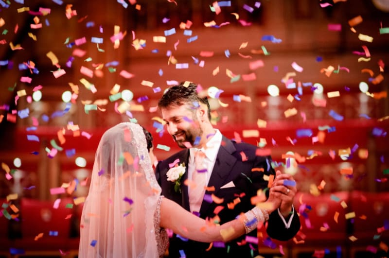 Bridebook.co.uk- bride and groom during first dance surrounded by confetti