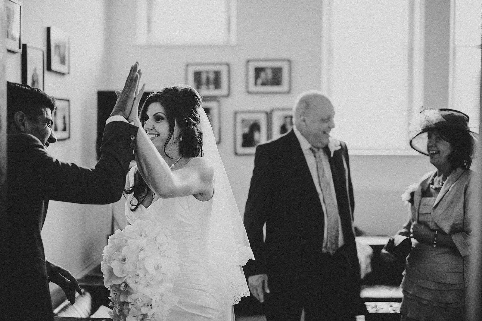 Bridebook.co.uk- bride and groom high five