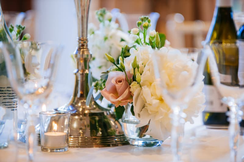 Bridebook.co.uk- table setting with flowers and candles