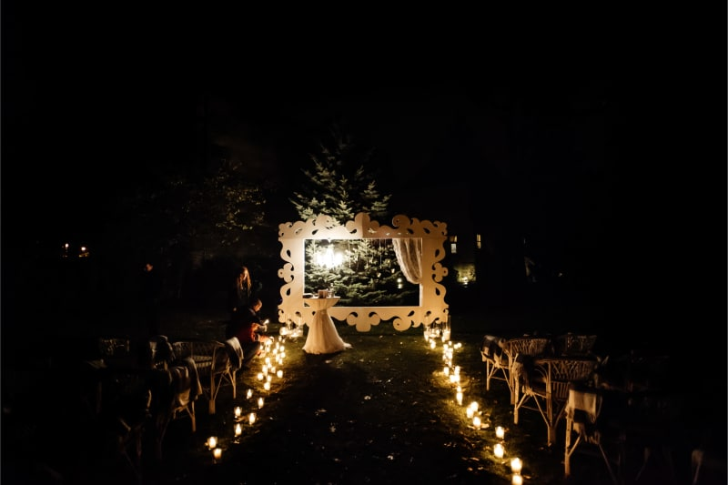 Bridebook.co.uk candlelit aisle nighttime ceremony