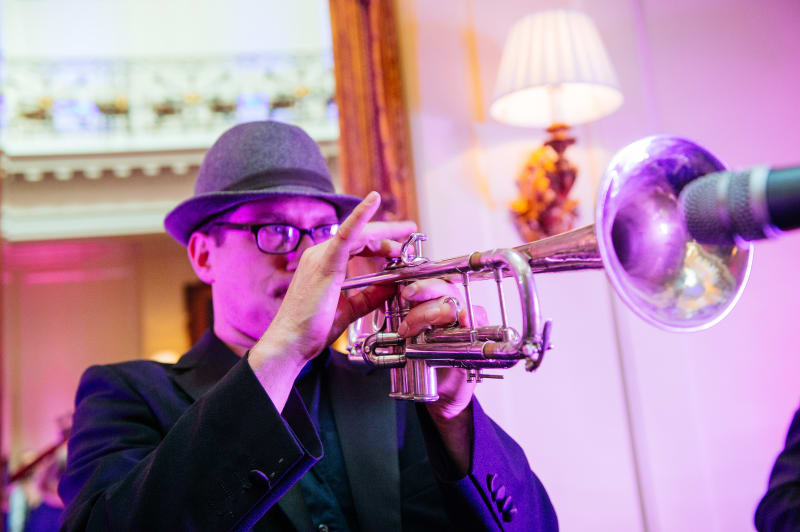 bridebook.co.uk  trumpeter playing at a wedding