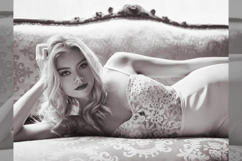 bridebook.co.uk model wearing jumpsuit lying down
