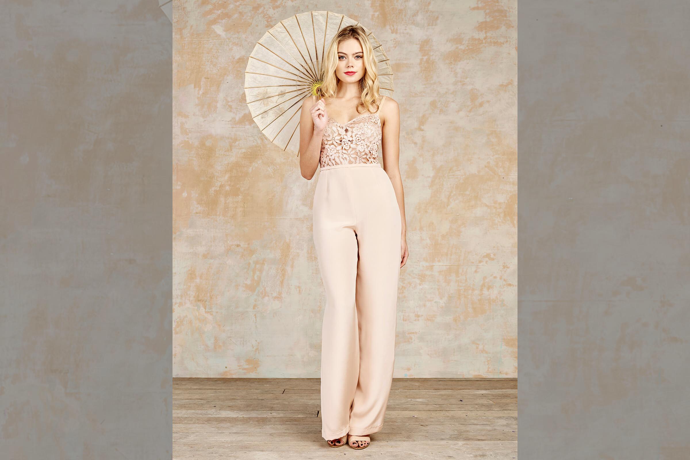 bridebook.co.uk-house-of-ollichon blush jumpuit model with parasol
