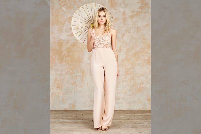 bridebook.co.uk-house-of-ollichon blush jumpuit model with parasol