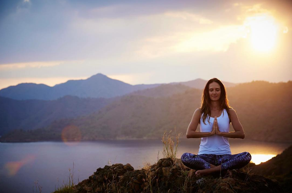 bridebook.co.uk young woman doing yoga in the mountains