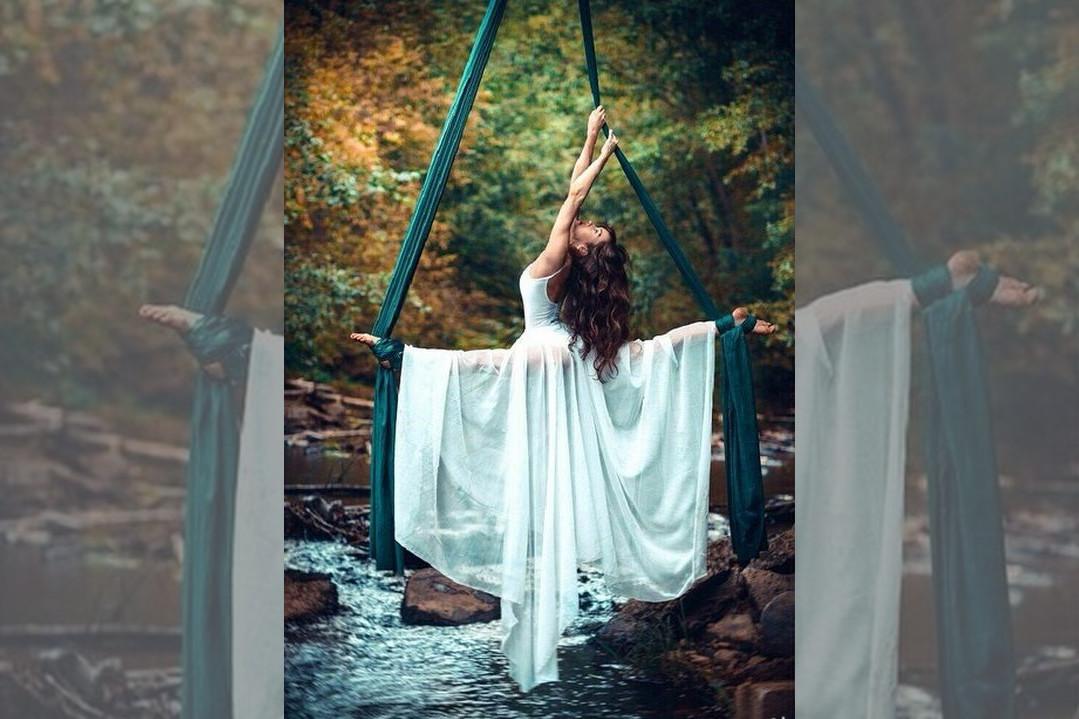 bridebook.co.uk-acrobatic bride above river