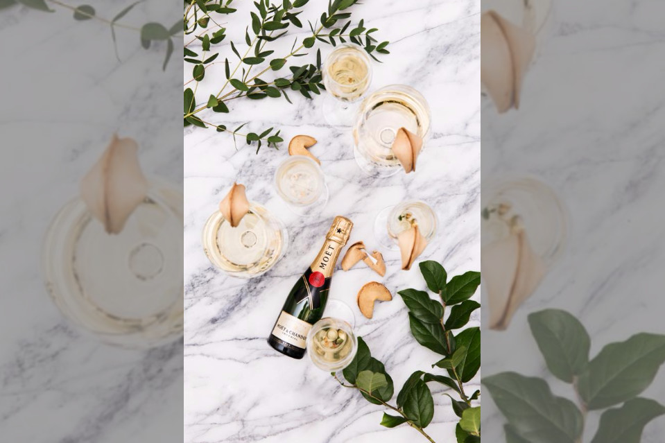 Bridebook.co.uk moet champagne on marble with leaves