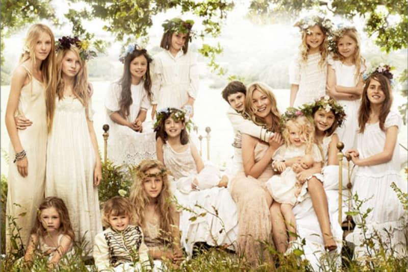 Bridebook.co.uk bride in wedding dress with bridal team
