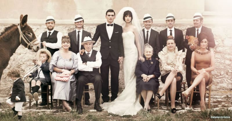 Bridebook.co.uk bride and groom with hair and makeup done with entire family