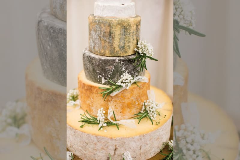 bridebook.co.uk cheese tower with white flowers