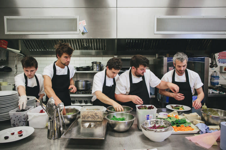 Bridebook.co.uk chefs in action prepping the wedding meal