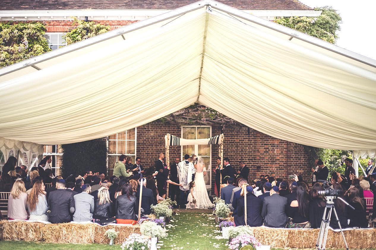 bridebook.co.uk-smashing-the-glass-rustic jewish wedding ceremony