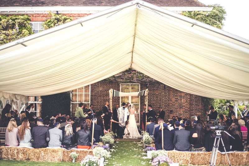 bridebook.co.uk-smashing-the-glass-rustic jewish wedding ceremony