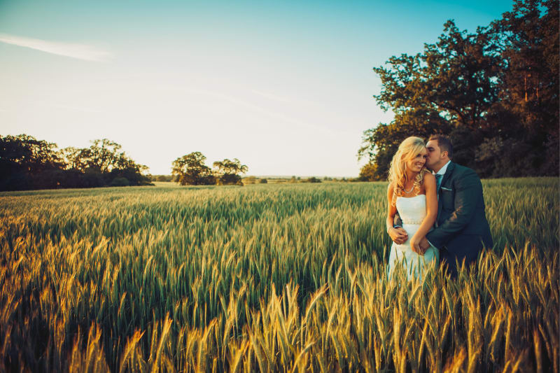 bridebook.co.uk couple in a wheat field