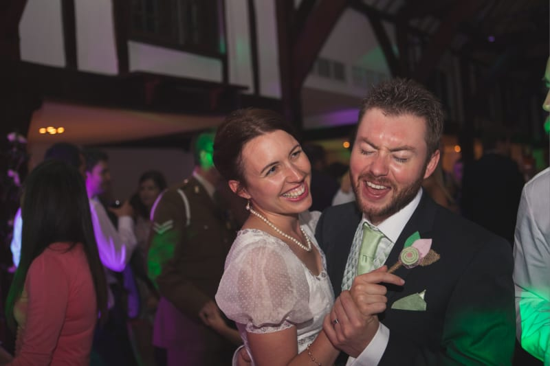 bridebook.co.uk happy bride and groom dancing