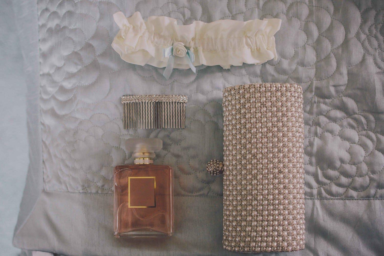 Bridebook.co.uk- bridal purse perfume hair grip and garter laid out