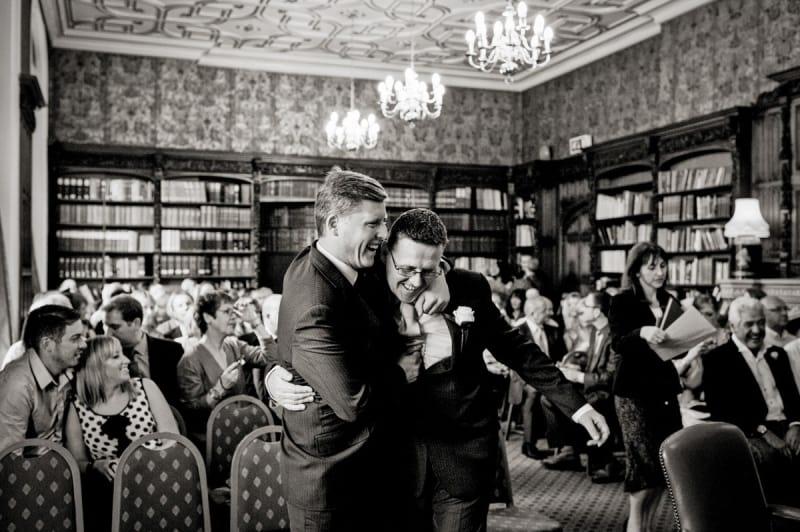 Bridebook.co.uk- groom and best man hug before the ceremony