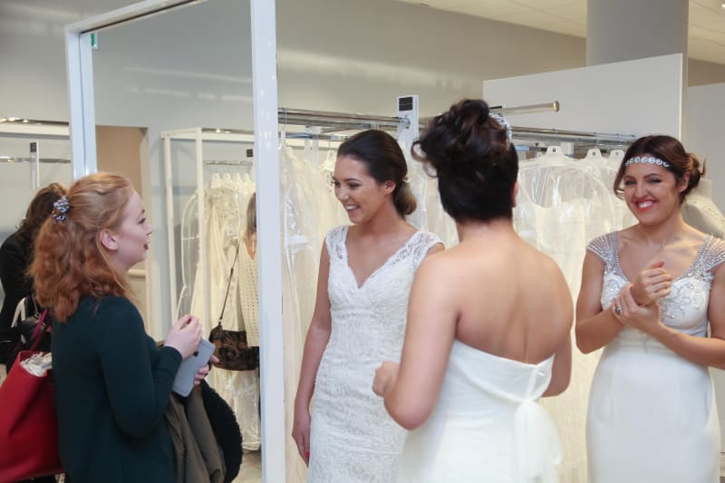 Bridebook.co.uk brides to be trying on dresses