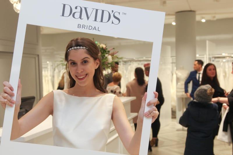 Bridebook.co.uk model holding a davids bridal frame