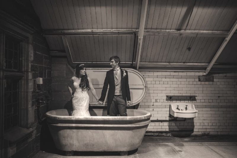 Bridebook.co.uk- bride and groom standing in a bathtub