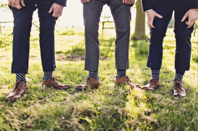 Bridebook.co.uk- ushers showing off matching polka dot socks