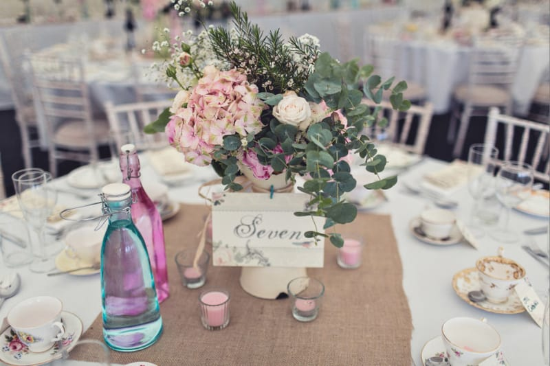 Bridebook.co.uk- table setting and name with flowers