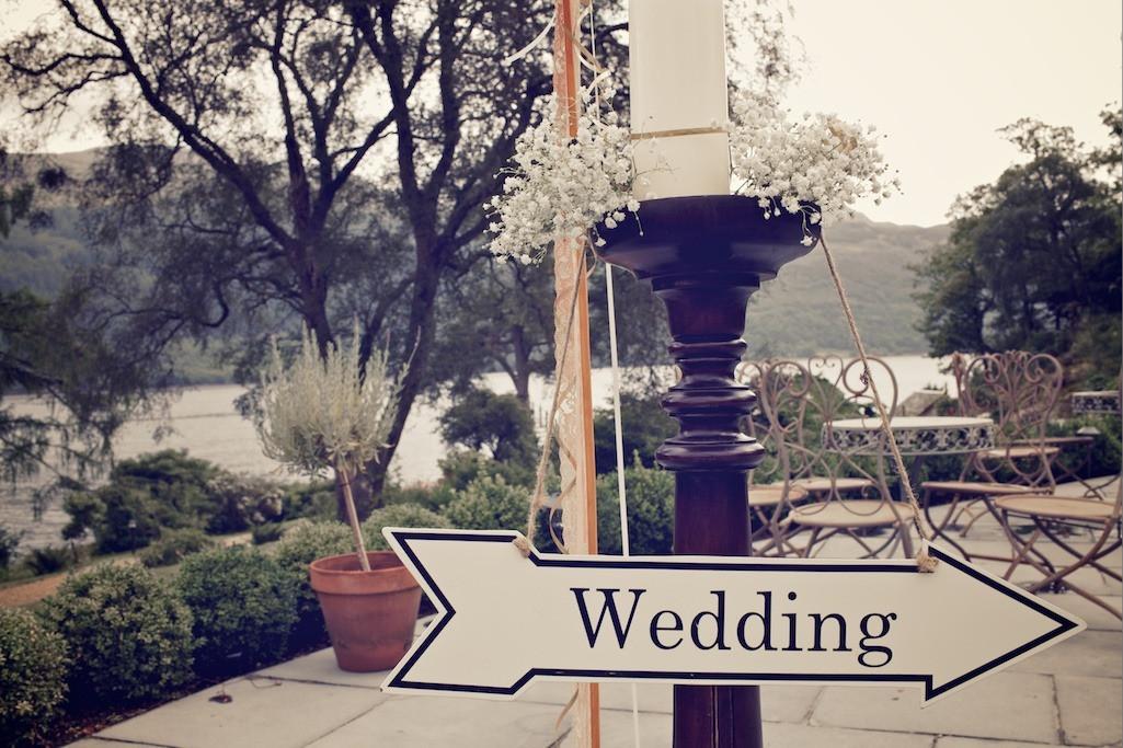Bridebook.co.uk- sign pointing to wedding reception