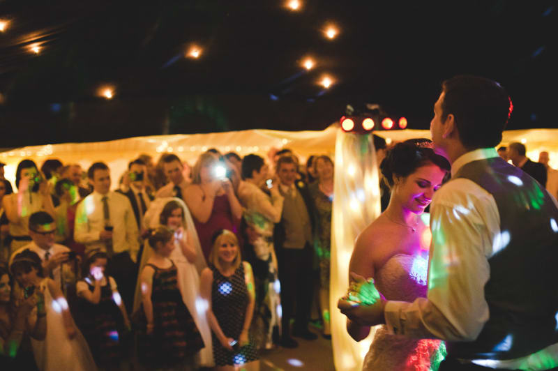 Bridebook.co.uk- bride and groom dancing as guests look on