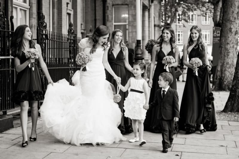 Bridebook.co.uk- bride and bridal party walking to ceremony