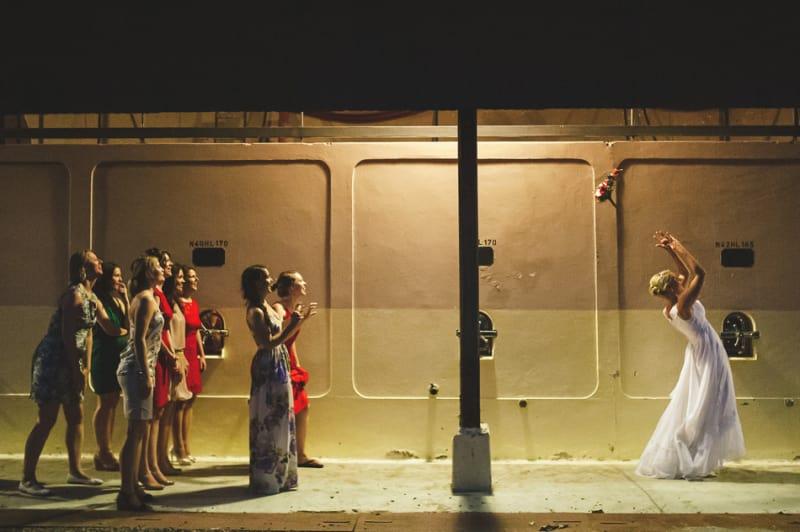 Bridebook.co.uk- bride tossing her wedding bouquet