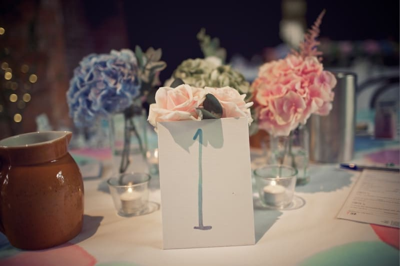 Bridebook.co.uk- table number propped up with flowers