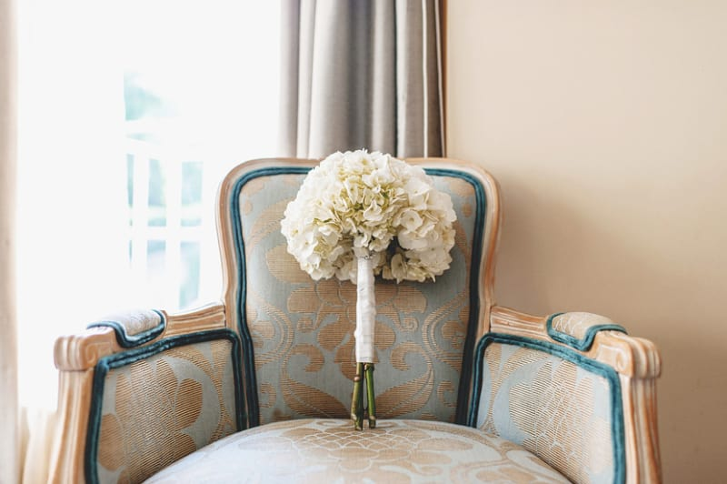 Bridebook.co.uk- white flower wedding bouquet on a chair