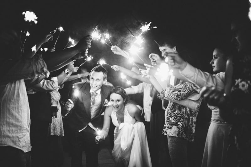 Bridebook.co.uk- Bride and groom walking under sparklers