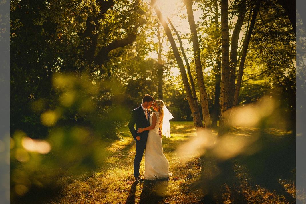 Bridebook.co.uk- bride and groom hugging in a forest