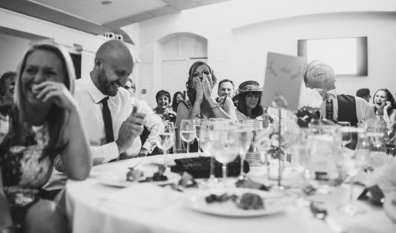 Bridebook.co.uk- Guest sitting at table and laughing