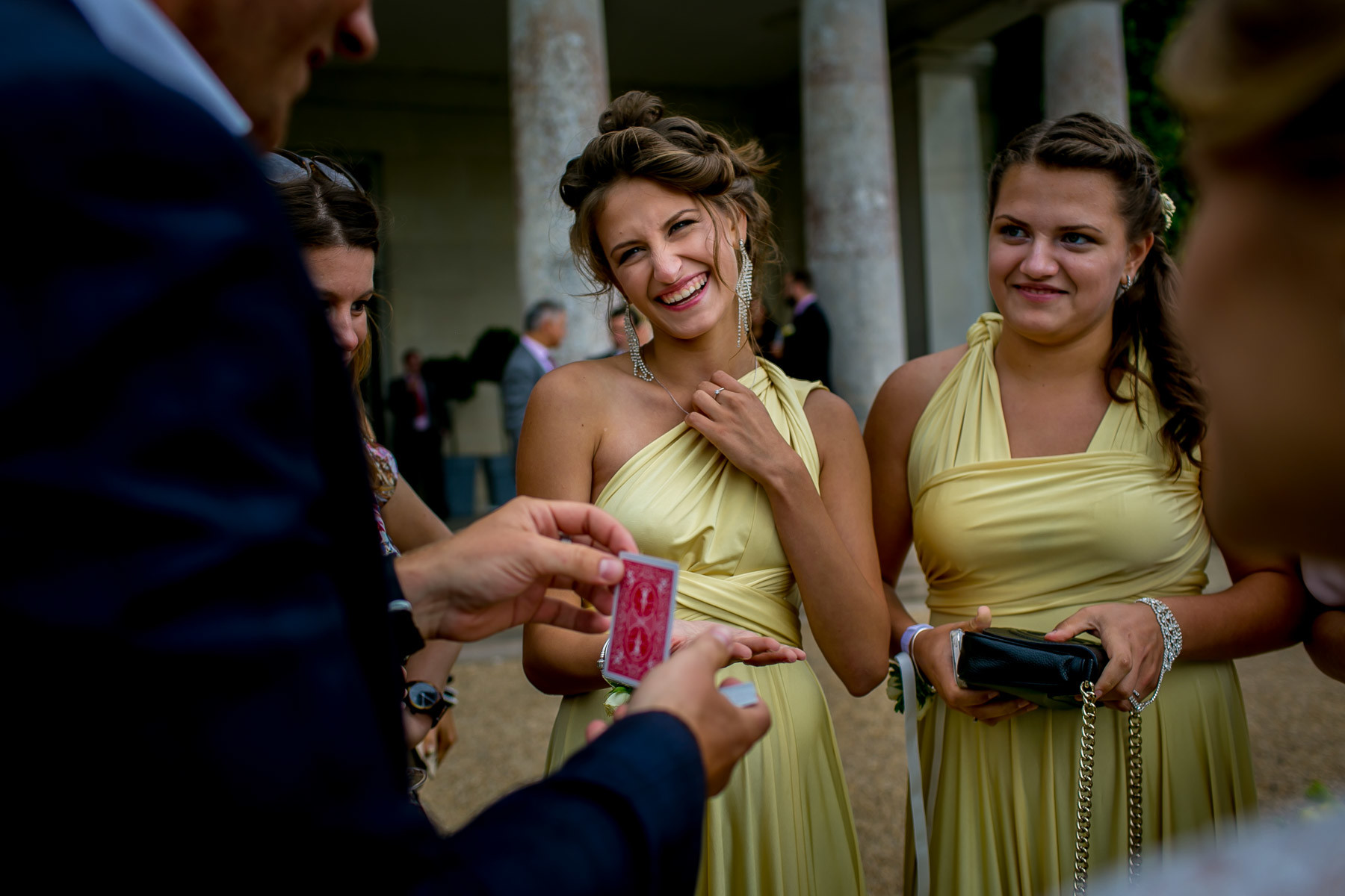 Bridebook.co.uk- bridesmaids being entertained by magician