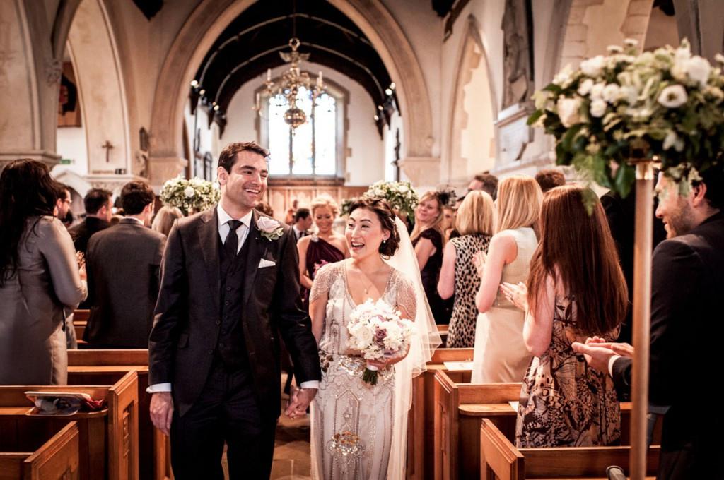 Bridebook.co.uk- bride and groom leaving ceremony after wedding