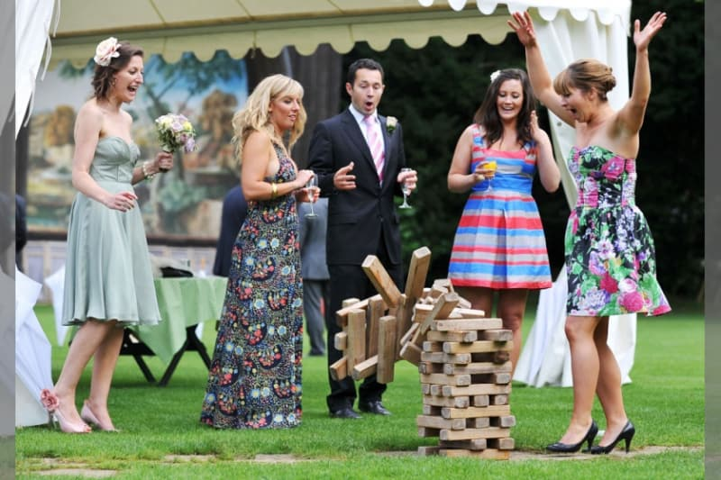 Bridebook.co.uk-  guests playing giant jenga on the lawn