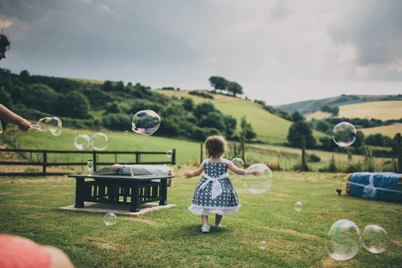Bridebook.co.uk- little girl playing with bubbles