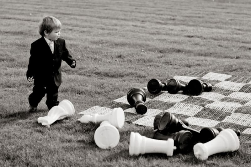 Bridebook.co.uk- boy playing with outdoor chess