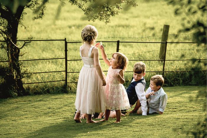 Bridebook.co.uk- kids playing in the sun at wedding