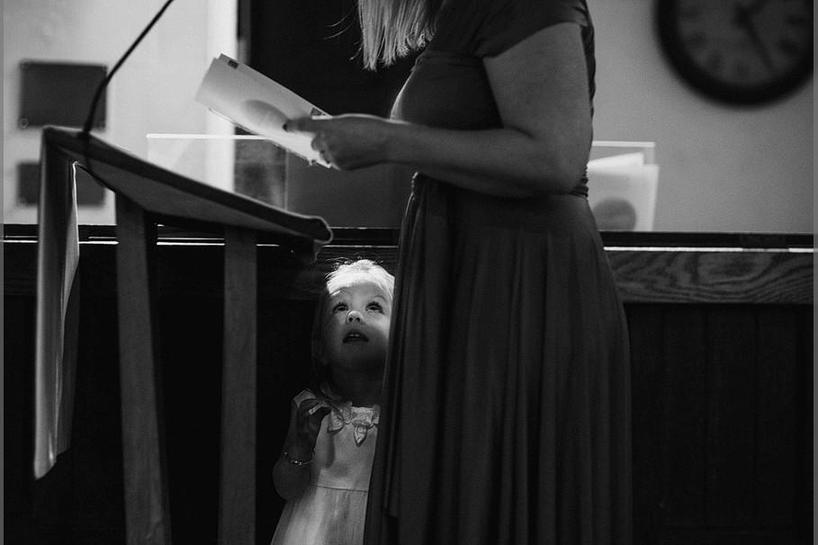 Bridebook.co.uk- child looking up at mum during wedding ceremony