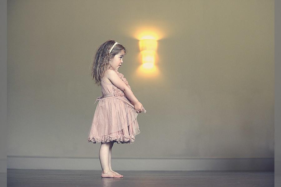 Bridebook.co.uk- flower girl standing barefoot