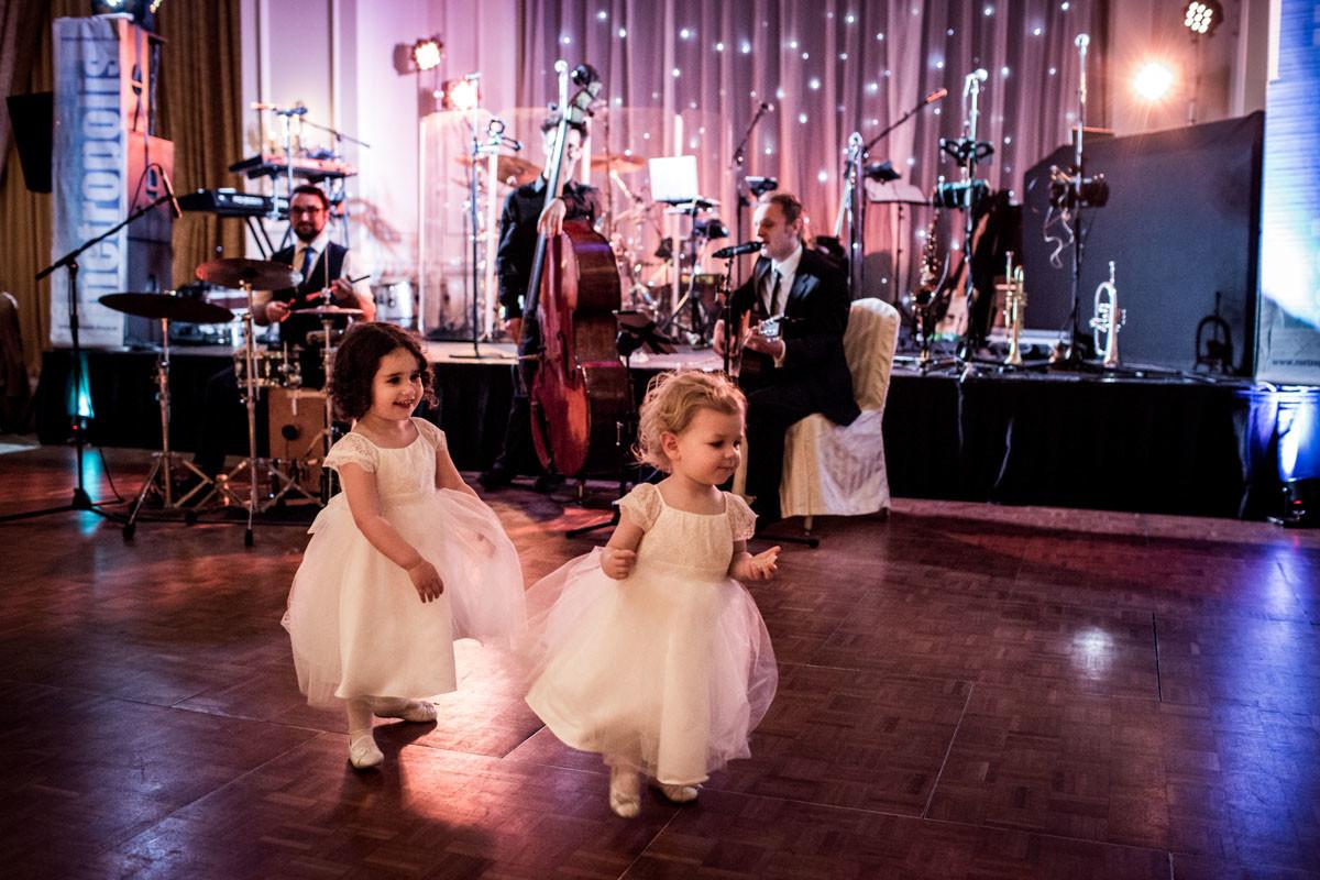 Bridebook.co.uk- flower girls running around the dancefloor