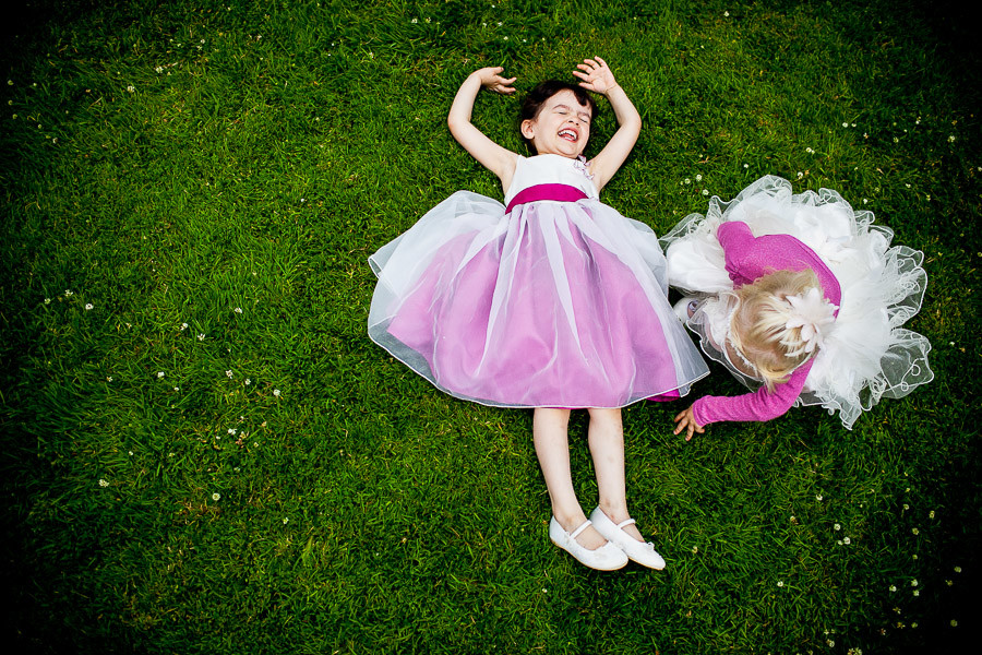 Bridebook.co.uk- Flower girls playing on the grass